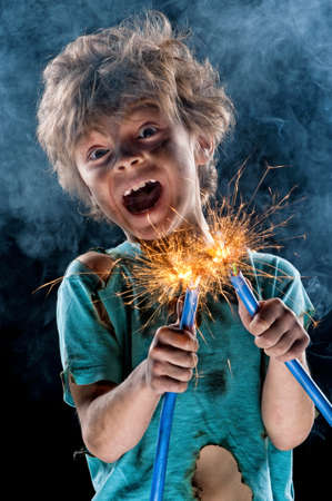 electrocute: Portrait of little crazy electrician over black background Stock Photo