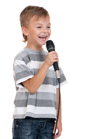 Little boy with microphone - isolated on white background photo