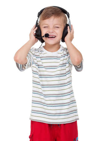Little boy with headphones - isolated on white background photo