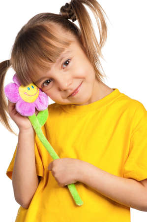 Portrait of happy little girl with flower isolated on white background photo