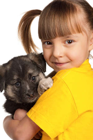 Portrait of little girl with cute puppy isolated on white background photo