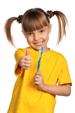 Portrait of happy little girl with tooth brush isolated on white background photo