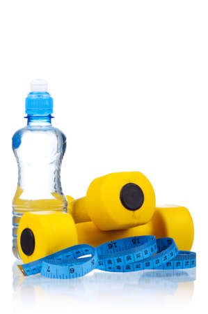 water aerobics: Yellow one kilogram dumbbells with bottled water and measuring tape isolated on white background