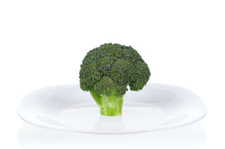 Fresh ripe broccoli piece on plate on white background Stock Photo - 12562393