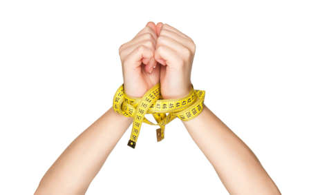 bondage girl: Woman hands with measure tape isolated on white background Stock Photo