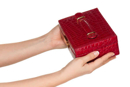 Woman hands with red box isolated on white background photo