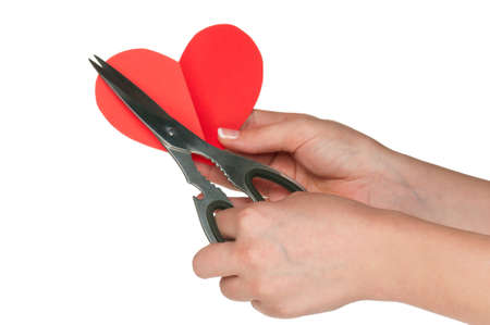 Woman hands with scissors and heart isolated on white background Stock Photo - 12562339