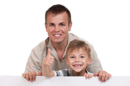 Portrait of happy dad and son with empty white board isolated on white background Stock Photo - 12562366