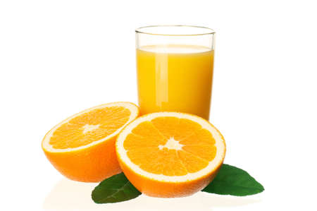 Glass of fresh orange juice and orange fruits with green leaves on white background photo