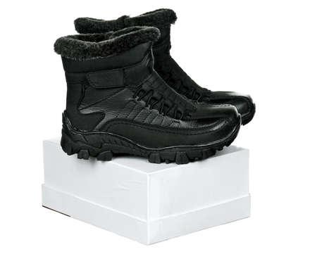 New boots children fashion on white background photo