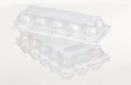 Empty plastic box for eggs on white background photo