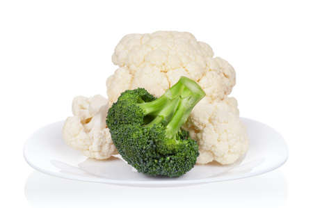 Fresh ripe broccoli piece and cauliflower cabbage on plate on white background Stock Photo - 12562027