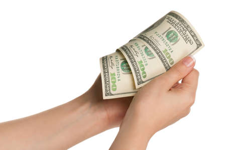 Woman hands with dollars isolated on white background photo