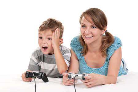 Happy family - mother and child playing a video game photo