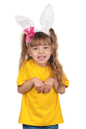 bunny ears: Portrait of happy little girl with bunny ears over white background