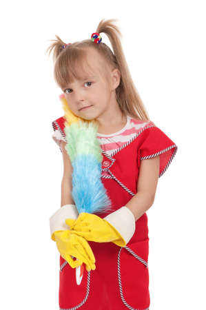 Portrait of beautiful little housewife with colorful duster isolated on white background  Stock Photo