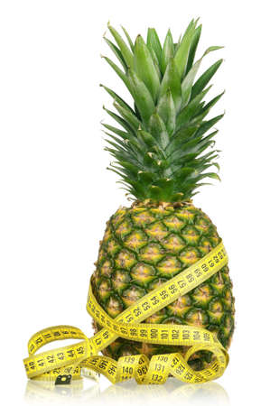 Fresh ripe pineapple with a measure tape isolated on white background photo