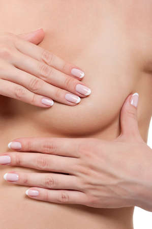nipple breast: Young woman examining her breast for lumps or signs of breast cancer