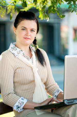 Modern young business woman with notebook computer in park outdoors Stock Photo - 12561772