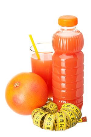 Fresh grapefruit juice with measure tape and grapefruit fruits on white background photo