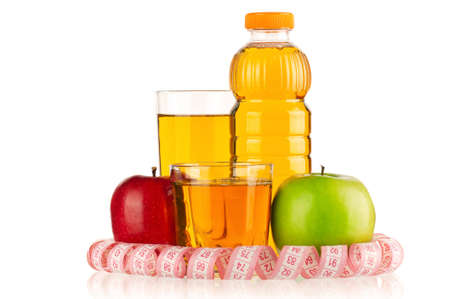 Apple juice in plastic bottle and glass with a measure tape isolated on white background photo