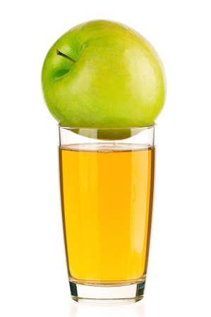 Apple juice in glass isolated on white background photo