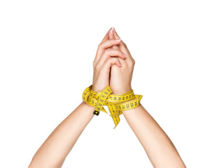Woman hands with measure tape isolated on white background photo