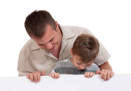 Portrait of happy dad and son with empty white board isolated on white background photo