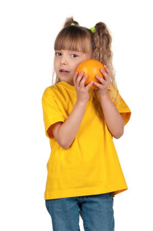 Portrait of happy little girl with grapefruit over white background Stock Photo - 12695234