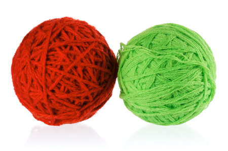 Red and green balls of yarn for knitting isolated on white background photo