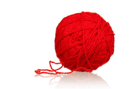 Red ball of yarn for knitting isolated on white background photo
