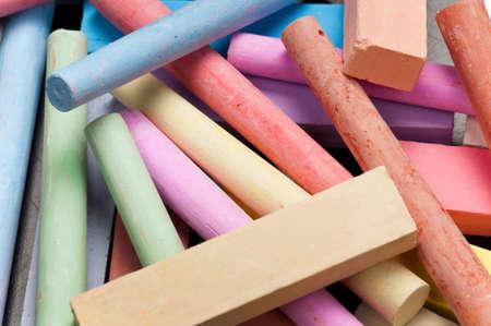Close-up of colorful large chalk sticks on blackboard photo