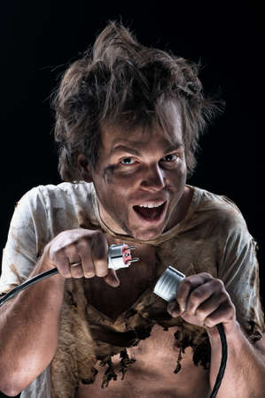 electrocute: Portrait of crazy electrician over black background Stock Photo