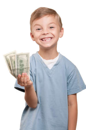 earn money: Portrait of a cheerful little boy holding a dollars over white background
