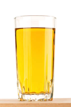 Apple juice in glass on wooden board over white background Stock Photo - 12696210