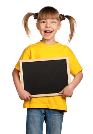 Portrait of little girl with blackboard isolated on white background photo