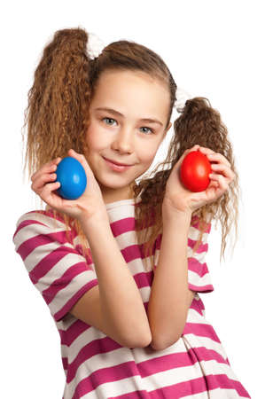 Portrait of happy girl with easter eggs isolated on white background photo