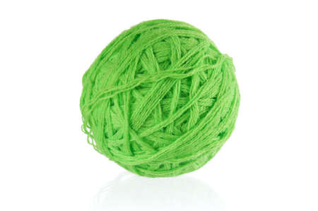 Green ball of yarn for knitting isolated on white background