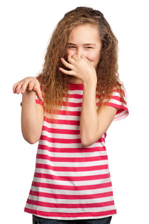 Portrait of girl covering nose with hand isolated on white background photo