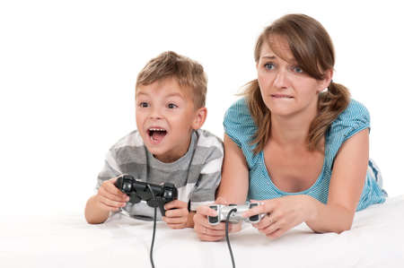 computer game: Happy family - mother and child playing a video game Stock Photo