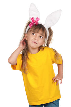 Portrait of happy little girl with bunny ears over white background  photo