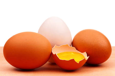 Fresh chicken eggs on wooden board over white background Stock Photo - 12833554