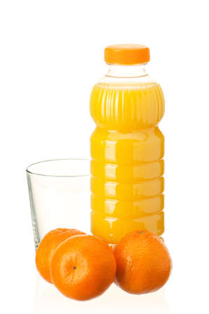 Mandarin juice in plastic bottle and mandarin fruits on white background photo