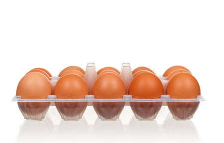 Brown eggs in the plastic box over white background photo