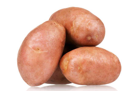 Heap of large raw potatoes on a white background Stock Photo - 12901102