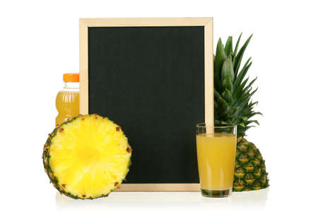 Fresh pineapple juice and ripe pineapple with a blackboard over white background photo
