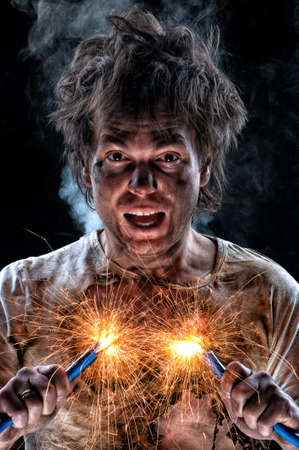 electric wire: Portrait of crazy electrician over black background Stock Photo