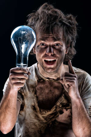 Portrait of funny electrician over black background photo