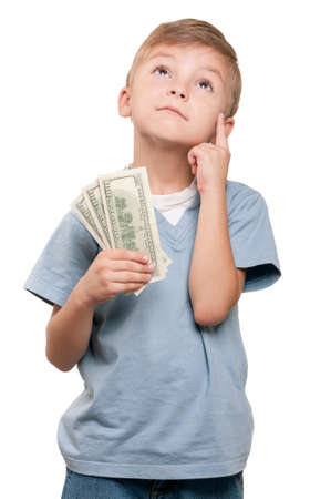 Portrait of a surprised little boy holding a dollars over white background photo