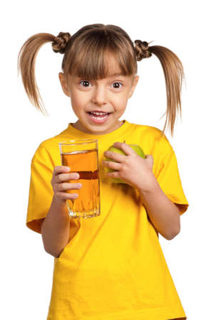 Portrait of surprised little girl with apple juice isolated on white background photo